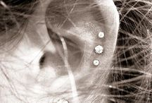 ear piercings and tattoos;)