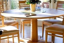 extending dining table with colourful chairs