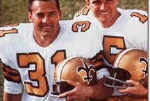 New Orleans Saints Old Days / The old days. I *CAN'T STAND* today's Saints uniforms with the black pants and the lightened beige. Their helmets and pants are not that deep gold anymore. Not a fan of Drew Brees either.