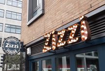 Zizzi Wigmore Street / Less than 5 minutes from London's busy Oxford Street and famous shopping destination Selfridges our Wigmore Street restaurant is spread over two floors, offering a warm atmosphere and relaxing break from a busy day of shopping. We have big long tables great for parties and lovely little alcoves for more intimate meals.