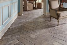 """""""Wood-Style"""" Tile Flooring / One of the latest trends in wood flooring isn't wood at all. It is tile manufactured to have the same beautiful rustic appeal as wood but the durability of tile. The latest technology has given the product the same variation piece by piece as that of natural wood."""