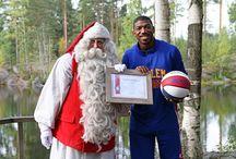 Santa Claus and the Harlem Globetrotters / Goodwill ambassadors Santa Claus and Buckets Blakes meet at Santa's Cottage in Espoo, Finland.