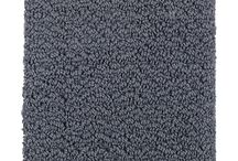 Studio D Carpet Selections / Every year, Mohawk keeps more than 3 billion plastic bottles out of landfills by recycling them into EverStrand® carpet. With a range of stain and wear resistance inherent to the individual strands, you are sure to find the right carpet for your home.  *Levels, pricing and product availability are subject to change without notice. For the most up-to-date selections and information, please schedule a visit with Studio D, the Dostie Homes Design Center.