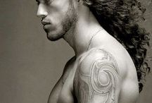 Long haired hot men preferably with tats and an attitude