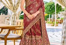 2680 HERITAGE 12 PARTY WEAR SAREE / Impress everyone with your amazing Trendy look by draping this maroon color two tone lycra pattern with glitter and bright georgette lehenga style with heavy work saree. this party wear saree won't fail to impress everyone around you. this gorgeous saree featuring a beautiful mix of designs. Its attractive color and designer embroidered design, patch design, attractive moti line, stone, beautiful floral design work over the attire & contrast hemline adds to the look.