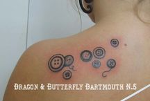 button tattoo