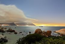 Bosky Dell / Bosky Dell (sheltered place) is perhaps the last secret hide-out of the Cape. In a truly unique setting directly above the iconic Boulders Beach, it seems lost in time…The views across False Bay to the Hottentots Holland Mountains are unparalleled from this Simon's Town accommodation establishment.