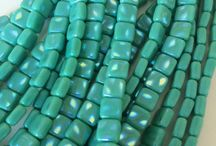Green Beads - May's Birthstone Color - Emerald - Inspires Us / Spring is in full bloom and the greens of May's flowers and emerald birthstone are everywhere. Check out the gorgeous greens available at Island Cove Beads & Gallery.