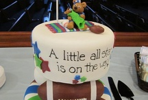 Sports Baby Shower Cakes / Sports Baby Shower Cake Ideas for those planning a sports theme baby shower party. / by Modern Baby Shower Ideas