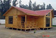 casa in L din lemn