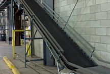 Used Incline Conveyor / Used incline conveyors move product between floors of a warehouse, including from floor level to a mezzanine, platform, and even from building to building. This saves valuable floor space by allowing the transportation of products to an overhead location without the use of a forklift.