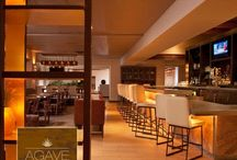 AGAVE Lounge / A Hip, Sophisticated Santa Fe Lounge. Enter a world of celebrated culinary delight and libations at Eldorado Hotel & Spa at the Agave Lounge. Building upon the award-winning dining foundations of The Old House, this Santa Fe lounge and bar features a menu of shared plates, specialty cocktails, and an extensive wine-by-the-glass program.