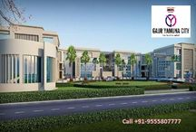 Gaur Yamuna City / Gaur Yamuna City is a residential township, offers flats, plots and commercial space located at Yamuna Expressway, Greater Noida.