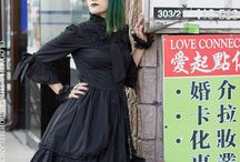 Gloomth Downtown Dark / Gothic model Mistress McCutchan explores busy Chinatown streets in a black gothic Victorian inspired dress by Gloomth. handmade fashion, green dyed hair, piercings and all sorts of neon signs!