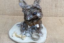 Dog caricatures / Making dogs from clay is such fun. They take on a life of their own and simply anything can happen.  Looking online I've found other potters who've also captured the essence of dog.
