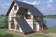 Проект Мини-гостиницы / Особенностью здания является перепады уровней на этажах и установка некоторых стен с уклоном наружу.     Фасад стилизован под фахверковые дома, в отделки применяется белая штукатурка и деревянная доска.