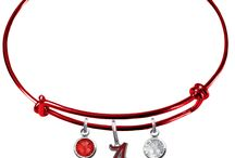 College Bangle Bracelets / All college teams available in stainless steel with team color crystal accents. New exclusive color edition bangle bracelets now available in a wide variety of team colors, only available from Sports Jewelry Pro Shop™.