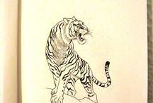Tattoos / by Kim Priestley Ramirez