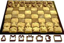 """Creative  Chessboards  / A chessboard is the type of checkerboard used in the board game chess, and consists of 64 squares (eight rows and eight columns) arranged in two alternating colors (light and dark). The colors are called """"black"""" and """"white"""" (or """"light"""" and """"dark""""), although the actual colors are usually dark green and buff for boards used in competition, and often natural shades of light and dark woods for home boards. Materials vary widely; while wooden boards are generally used in high-level games..."""