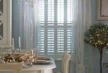 Window shutters with curtains