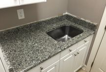 Vanities-A Variety of Granite Colors / Granite, Quartz and Marble- Vanities Fireplace and Granite has installed in February. This will give you a good idea of the different colors available.