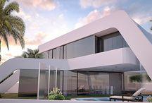 Vivienda Unifamiliar Cascada / Diseño de vivienda unifamiliar en zona de playa. En la arquitectura de la vivienda destaca la presencia de una lámina de agua en cascada que crea un microclima que enfría todo el perímetro. Sus líneas inclinadas generan espacios dinámicos. Para el interior de la vivienda se plantea un interiorismo minimalista y de formas sencillas con espacio muy abiertos.