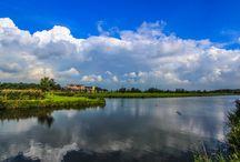 Zon, water & Wolken
