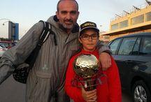 WSK Champions Cup 2014  /  Mert Dalkiran και Χουρλιας Θανασης, μαζι με τον  προπονητή τους Γιώργο Πολυχρονίδη έλαβαν μέρος στο WSK Champions Cup 2014 και κατέκτησαν την 3η και 15η θέση αντιστοιχα!
