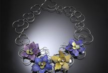 Linda Threadgill: Sculptural Jewelery - Mobilia Gallery / Linda Threadgill holds a Master of Fine Arts degree from Tyler School of Art in Philadelphia. She is a recipient of a National Endowment for the Arts Individual Fellowship and an Artisan Member of the Society of American Silversmiths.