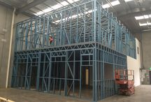 Factory Fitout 1 / This internal fit-out of a tilt slab factory extends the office area considerably. Double story, big open spaces and up in two full days with two guys. Sure beats stick building stock studs on site and hanging ceilings.