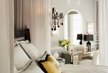 Interior Design Style:  Hollywood Regency / originated in what was considered the golden age of Hollywood – the 1930s. It is characterized by high-gloss glamour, bold colors often tempered with black and white, luxe elements like velvet, crystal-dangled chandeliers, shiny silvery finishes and silks and  lacquered furniture.
