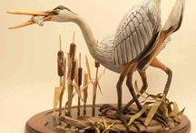 Wood Carvings and sculptures / Using the beauty of different types of wood to create art.  / by Steve Freeman