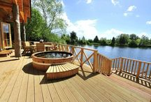 Our Log Cabins / Log House Holidays is a family run nature reserve in the Cotswolds. Authentic Scandinavian luxury awaits in just eight luxury log cabins. Each log house is totally secluded and comes with its own steaming hot tub, cosy log fire and romantic rowing boat...