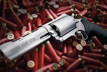 Taurus handguns / by Howard Esser