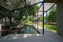 House on a Stream / House on a Stream - With a stream running through the house, this sustainable retreat in Alibag is delicately woven into the landscape. Elegant timber screens balance the greyness of the the extensively used concrete. They not only form a buffer between the interior space and the exteriors, but also create an intensive play of shadow and light on the floors and walls.