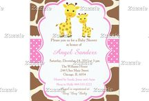 Giraffe Pink Polka Dots / This design features cute giraffes, mother and baby, with a giraffe print background and a pink polka dot ribbon.