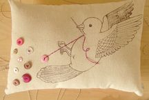 The bird sewing on button