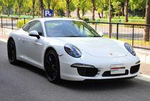 Porsche 911 Carrera S (type 991) ホワイト / 年式 2014 シフト 7速 ハンドル R 初度登録 平成26年3月 排気量 3,800cc 走行距離 1,200Km 車検期限 平成29年3月6日 ミッション PDK 修復歴 なし カラー(外装) ホワイト カラー(内装) レザーインテリア/ブラック  装備オプション カスタムレザーインテリア スポーツクロノパッケージ BOSEサウンドシステム スポーツデザインステアリング シートヒーター(フロント) フロアマット スモーカーパッケージ ブラックカラー塗装ホイール スポーツテールパイプ PDLS(ブラック) アルミフットレスペダル