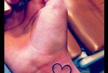 Tattoos/Peircings / by Jena Lunzman