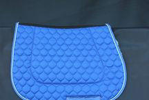 Showjumping Saddle Blankets / 4 Styles: VJ forward cut; Shaped; Flashback and GP/Jumping. Comes as plain, piped or with fluffies. Huge colour range. We can custom make to your requirements. Phone +6427 276 9158  bjmerinonz@hotmail.com
