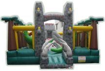 Dinosaur Themed Inflatable Bouncer / Having a dinosaur party? Rent a bouncy castle to bump up the fun!
