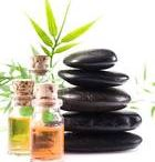 Hot rock massage / Enjoy the therapeutic heat of the Basalt Rocks during a 90 min Hahana deluxe full body massage
