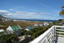 Glencairn Apartment / Enjoy peace and quiet in this well-equipped light, spacious and airy upper floor two-bedroom apartment with wetland, mountain and sea views. The apartment is a short walk from the beach, train station and two local restaurants.