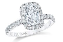 Aspiri Diamonds By Maiden Lane / All rings and jewelry are complete and feature a dazzling ASPIRI cut center stone, one that looks 25% – 50% larger than a similar stone of equal carat weight. A fine quality halo setting enhances its sophistication and accentuates the center diamond, resulting in a gorgeous piece that is both impressive and affordable.