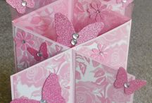 cascading cards and flowers in a  box