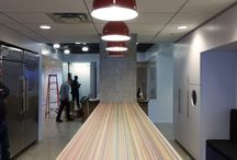 Varonis HQ New York 2015 / Focused constructed two customized table-tops for theglobal headquarters of Varonis in NYC. The showpiece is the long parsons table with a side panel. The lines of the top of this table continue into the side panel, resulting in a colorful waterfall. Together with the matching smaller banquette table it forms a unique piece in the center of the new community on the floor. A total number of 110 skateboard decks have been recycled into these two pieces. Photo's by Liam Frederick