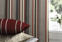 Curtains / Nothing says luxury quite like a pair of sumptuous curtains at a window. Available in a number of style options, from pinch pleat to pencil pleat, with various additional finishes such as pelmets and tie backs, our range of made to measure curtains offer the ideal bespoke solution to any window.