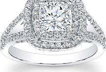 Ladies Rings and Bling / I believe that the more classic the more classy.  You get too fancy and it doesn't look like a wedding band anymore