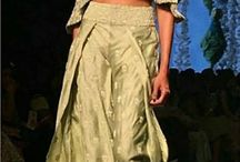 Noor By SVA Couture, SS 2017 / SVA is the labour of love by Sonam & Paras Modi. Noor is Inspired by the playful beauty and dynamic grace of Mughal era nautch girls, with references to the British Raj in its hints of modernity. It brought attraction to the ramp via interesting drapes, free flowing sleeves contrasted with structured jackets with a cold-shoulder twist in hues of burnt rose, shadow grey, lint and green tea. Bridelan: Personal Shopper & Style Consultants for Indian/NRI weddings. Website www.bridelan.com