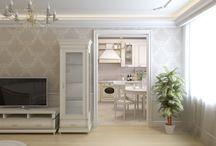 Апартаменты в классическом стиле / Интерьер был создан в легких, светлых тонах. Современная техника, гармонично интегрировались в классическую и функциональную мебель. В спальне, напротив фотогалереи было решено устроить стену из фрагментов зеркал, для визуального увеличения пространства. На полу разместился натуральный ковер, для создания максимального уюта и мягкости помещения.